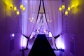 Black and white man-made tunnel with Lucite candelabras