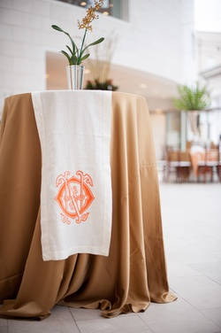 Cocktail table with wedding monogram linen runner