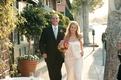 newlyweds walk down charming city street