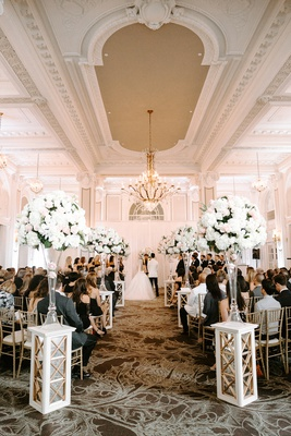 ballroom wedding ceremony georgian ballrooms white pink flower arrangements gold chairs chandelier