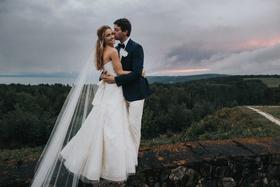 sunset wedding photo strapless vera wang wedding dress in canada veil long hair