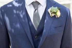 groom in navy blue three piece suit grey tie succulenet wedding boutonniere rustic chic