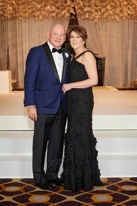 wedding portrait father of groom mother of groom black dress high neck navy tuxedo bow tie