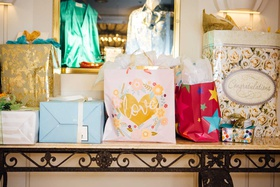 wedding shower gift bags from guests on console table beverly hills ballroom