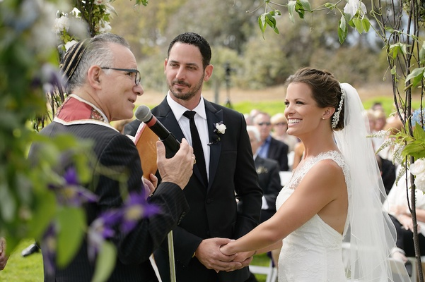 Melissa Claire Egan and husband at outdoor wedding ceremony