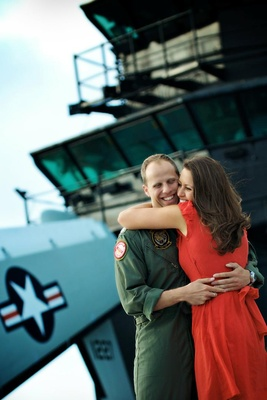 US Navy lieutenant and wife on military boat