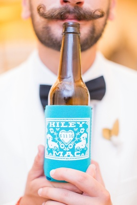 Kiley and Mac personalized beer koozie bright blue on brown beer bottle mustache guest texas wedding