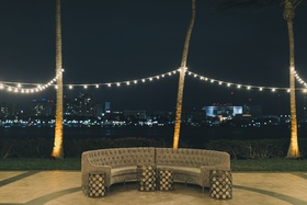 outdoor cocktail hour, outdoor lounge area grey couch, bistro lighting