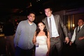 Bride in a strapless Vera Wang gown, beaded sash with NY Knicks forward Louis Amundson at reception