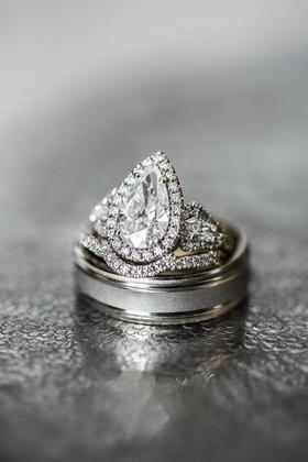 pear-shaped diamond three-stone halo engagement ring with men's wedding band