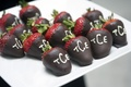 chocolate covered strawberries with initials in icing