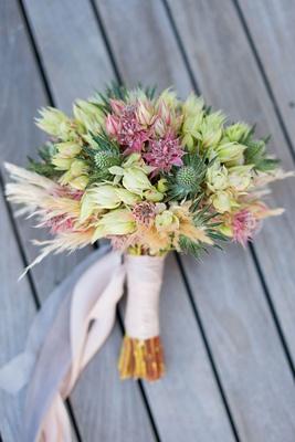 wedding bouquet thistle protea unique bridal bouquet pink light pink ribbon wrapped stems
