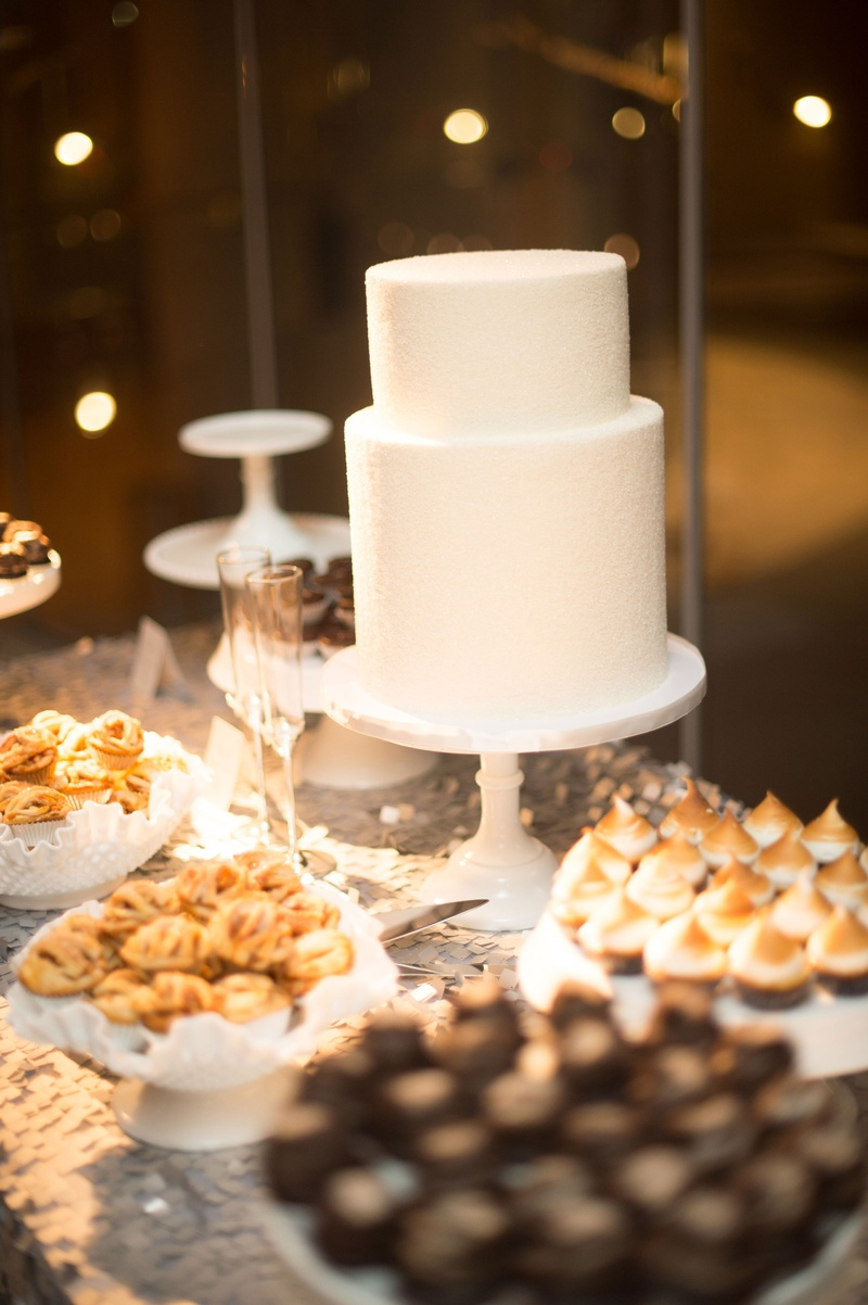 Two layer cake and dessert bar on sequin linen