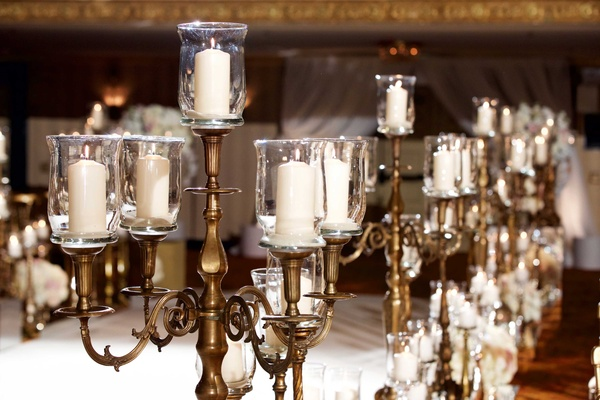 Candelabra along wedding ceremony aisle in Chicago ballroom