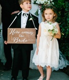 Flower girl in lace flower girl dress with flower crown ring bearer wood sign
