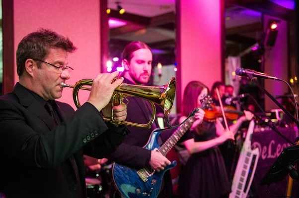 Men playing trumpet and bass guitar at reception