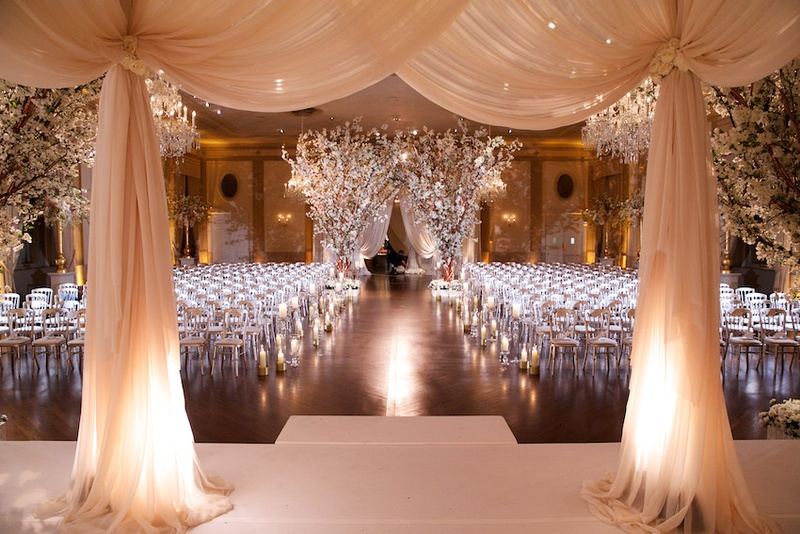 All White Indoor Wedding Ceremony Site: Elegant Drapery At Indoor Ceremony