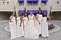 bride in legends romona keveza a-line wedding dress and illusion neckline, bridesmaids in white