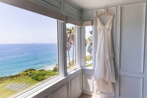 christos wedding dress with v-neck, waist detail, layered skirt, bridal suite with ocean view
