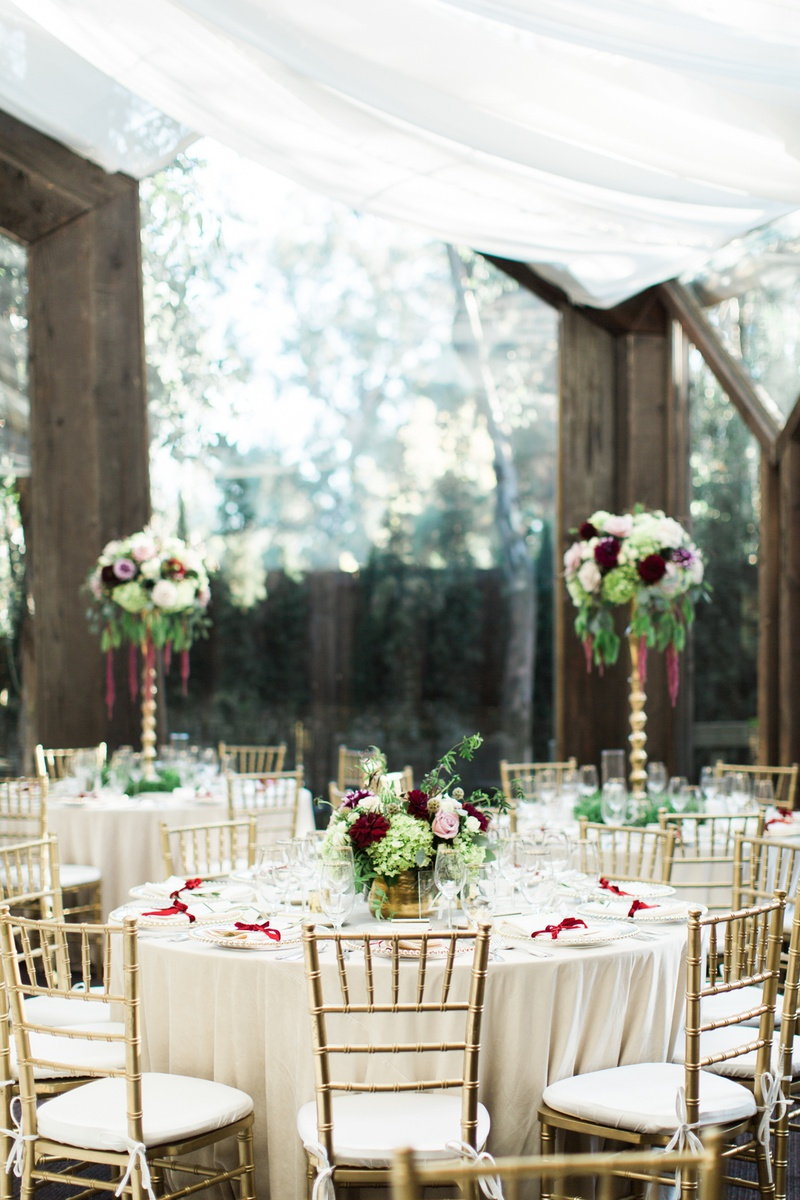 calamigos ranch oak room wedding reception with wooden beams and tall windows