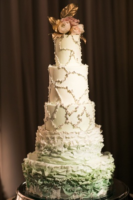 Five layer wedding cake two ruffle layers at bottom and pearl beaded design on top three tiers fresh