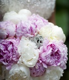 Wedding bouquet of white and light pink peonies, rhinestone brooch