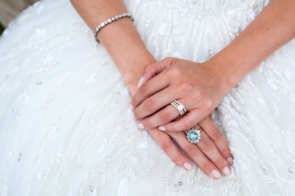 Bride in Zuhair Murad wedding dress Kleinfeld Brideal engagement ring and grandmother's blue diamond