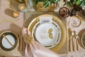 quirky wedding inspiration, salad plates with puns gold flatware gold napkin ring