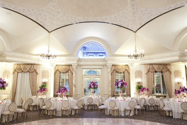Wedding reception with purple & pink centerpieces at the grand ballroom of the Pleasantdale Chateau