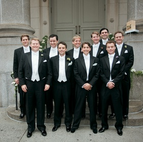 Men outside in long tail tuxdos