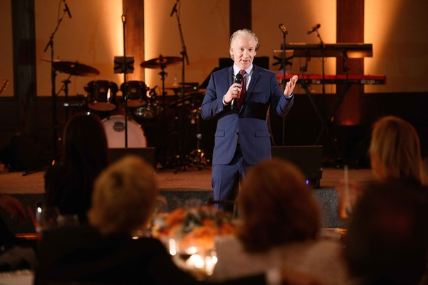 Bill Maher giving a toast at the wedding reception Carol Leifer and Lori Wolf