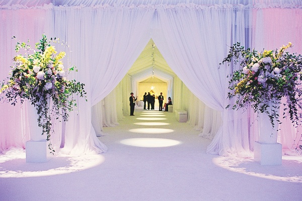 Structure decorated with white drapery for wedding events