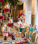 vibrant turquoise pink gold purple green reception tablescape bright linen tall floral centerpiece