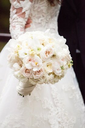classic bridal bouquet with ivory roses, pale blush rose, orchids