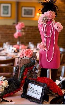 Black framed table name and pink mannequin centerpiece