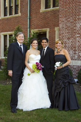Parents of the bride with groom and daughter
