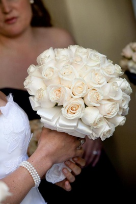 Ivory roses tied with layered white ribbon