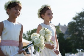 Flower girls with crowns and wands in pink sash dresses