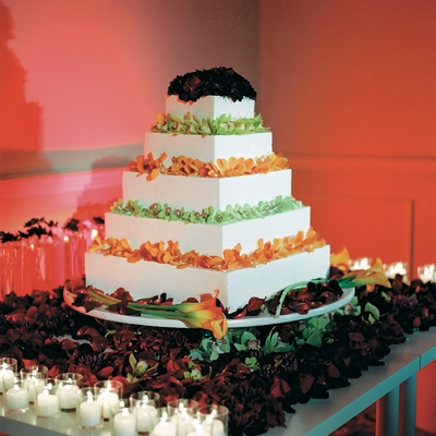Five layer white cake topped with orchid and calla lily flowers