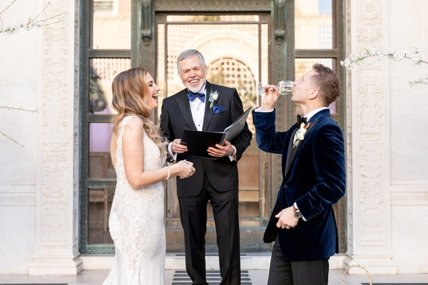 wine unity ceremony during ceremony, groom drinking wine during wedding ceremony