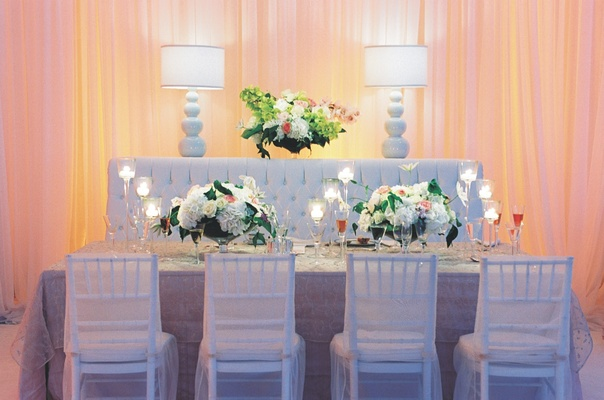 White reception decorations with tufted upholstered seating