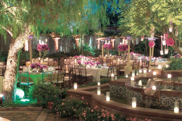 evening reception with pink flowers and candlelight bride