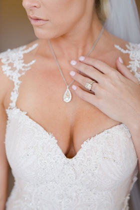 Barbie Blank in Galia Lahav wedding dress with teardrop diamond necklace and large engagement ring