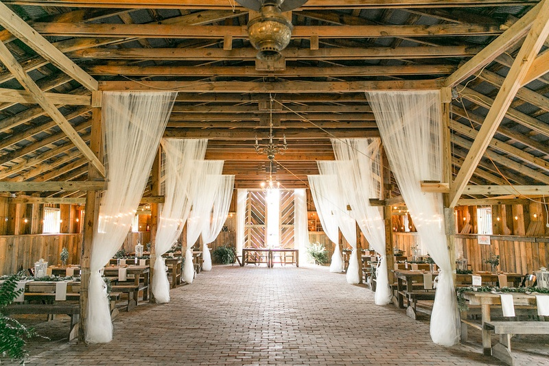 Locations venues photos vintage barn wedding reception inside white drapery from wood rafters beams barn rustic wedding ideas locations venues junglespirit Choice Image