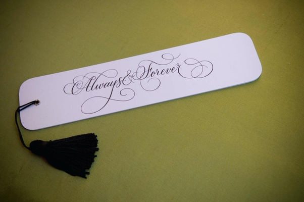 Fan style wedding program with black tassel