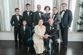 couple celebrating 50th wedding anniversary pose with their family, children and grandchildren