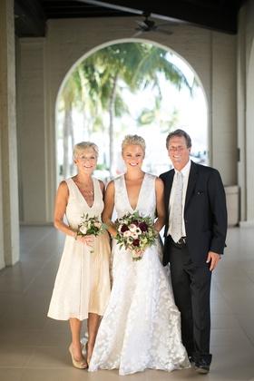 Bride in deep v wedding dress with mother of bride in short knee length dress v neck beige heels