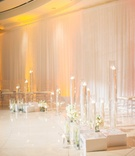 Short pedestals with floating flowers and candlelight