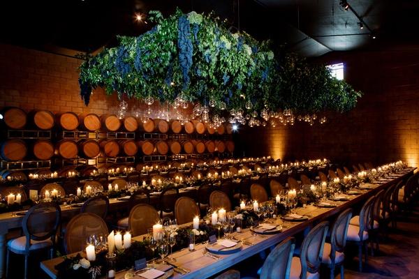 Rehearsal Dinner Inside Barrel Room With Grape Lighting Fixture