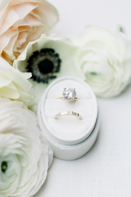 large round diamond on solitaire band, wedding band with pavé baguettes, rings in oval ring box